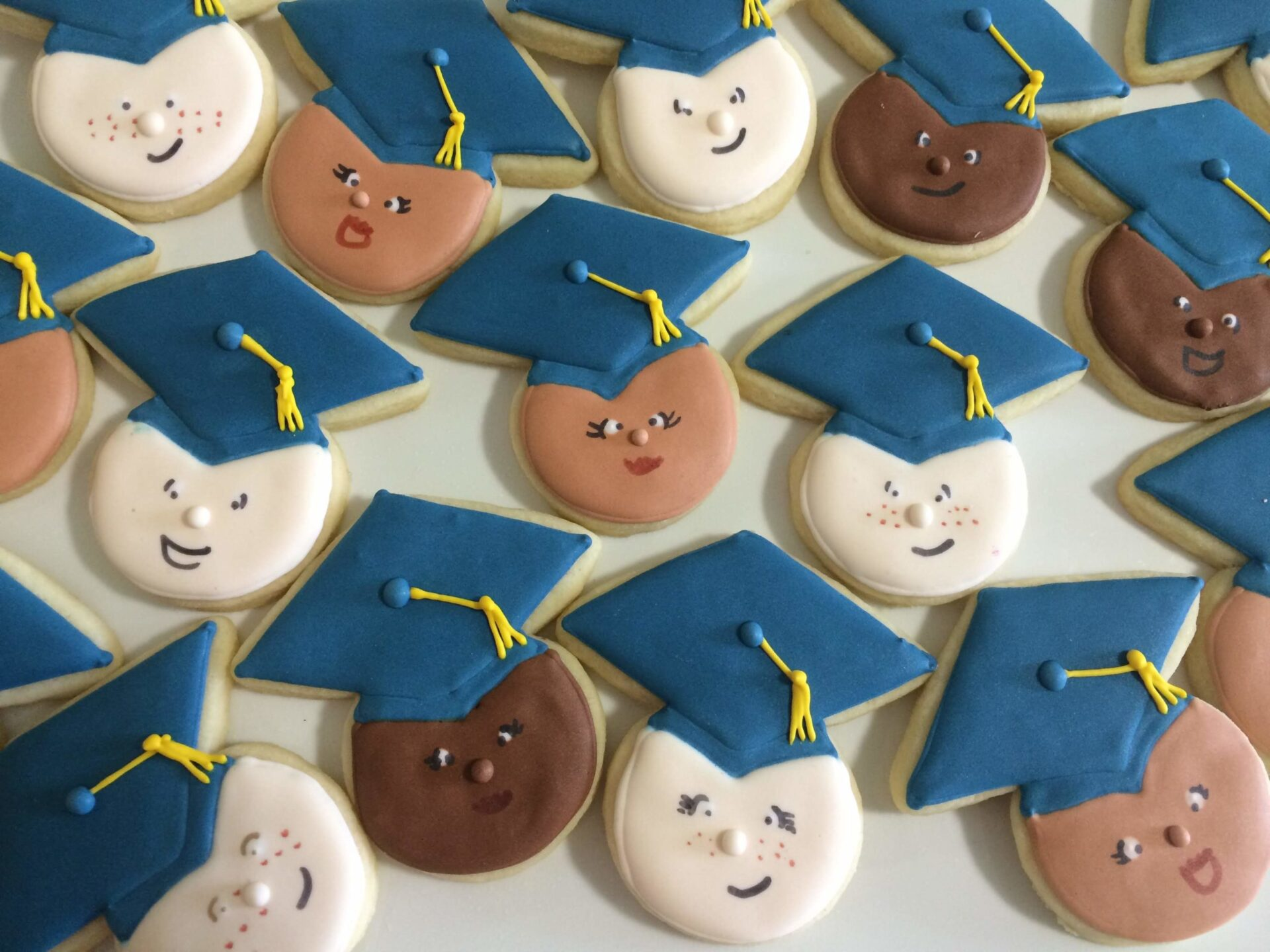 diverse graduate sugar cookies royal icing